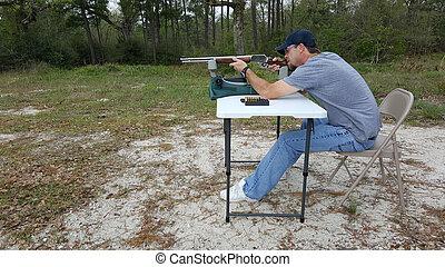 Hunter Aiming Rifle Down Range