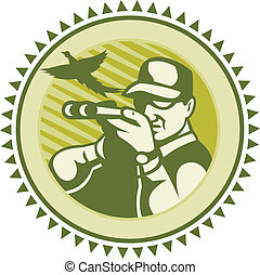 Illustration of a male hunter shooter aiming shotgun rifle with pheasant bird flying done in retro woodcut style.