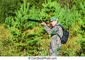 Hunter at the ready for shooting
