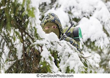 Hunter hidden in the backwoods