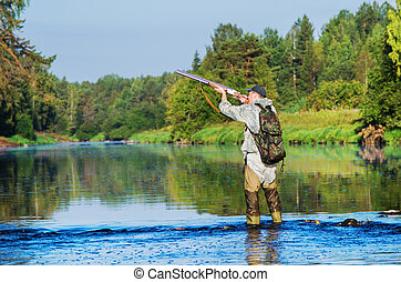 Hunter hunting duck