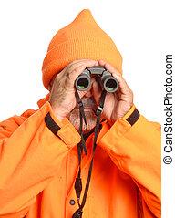 hunter in blaze orange gear looking through binoculars...