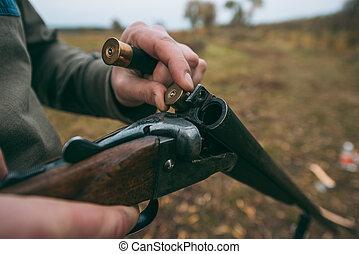 hunter loading gun with bullets