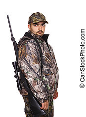 Hunter looking over right shoulder, wearing camouflage and holding a rife, isolated on white