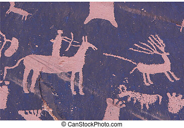 Petrolyph of horse rider hunting elk with bow and arrow. Newspaper Rock State Park, Utah, U.S.A.
