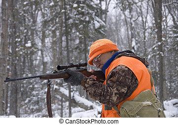 hunter season 3 - Senior hunter aiming a deer in his sight ...