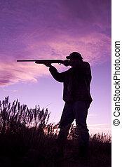 Hunter shooting in Sunset