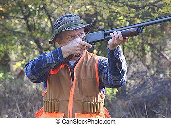 Hunter Shooting - Man shooting a shotgun while hunting