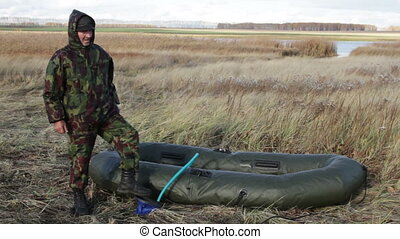Hunter pumps up an inflatable boat