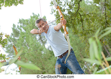 hunter using a bow and arrow