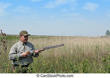 hunter waiting for wild ducks