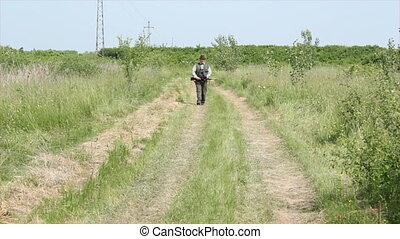 hunter walking and aiming