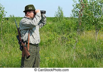 hunter with binoculars