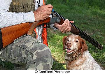 Hunter with dog and shotgun