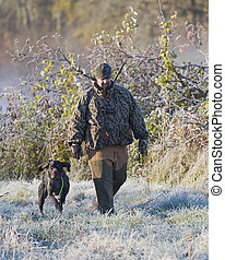 Hunter with his dog - Hunter with his hunting dog