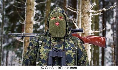 Hunter with optical rifle