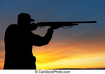 hunter with rifle gun - hunter aiming the hunting rifle...