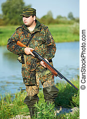 hunter with rifle gun - Male hunter in camouflage clothes...