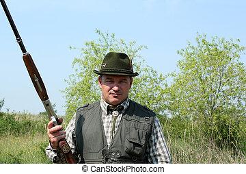 hunter with shotgun portrait