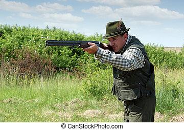 hunter with shotgun ready for shot