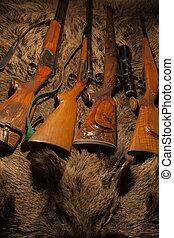hunting gun on the skin of wild boar