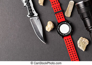 Hunting objects, folding hunting knife , red smartwatch and...