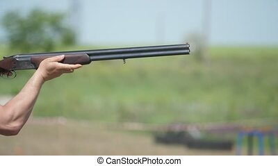Hunting over and under gun shooting clay targets on a big...