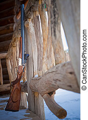 hunting rifle on the terrace of the lodge. - hunting rifle ...