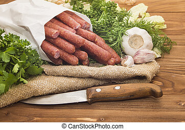 hunting sausages in a white package