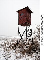 Hunting tower in winter country
