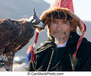 """Hunting with eagles in the Mongolian Altai. Traditionally Kazakh fun. """"The Golden Eagle Festival"""""""