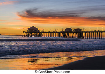 Huntington Beach Pier at Sunset - Surreal scenery as the sun...