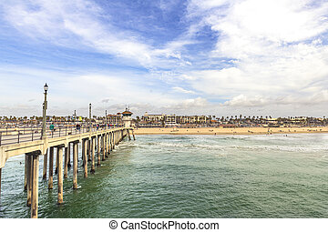 The iconic Huntington Beach pier hosts millions of tourists annually.  The views are simply beautiful, especially during vibrant sunny days.