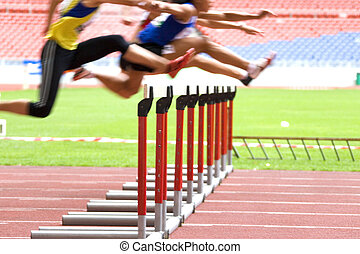 Hurdlers in Action - Image of hurdles in action at a stadium...
