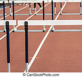 Hurdles on a red indoor track