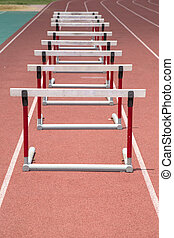 hurdles on the red running track prepared for competition
