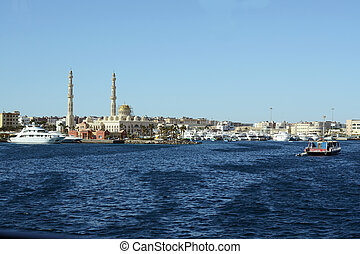 Hurghada sea side view with central muslim mosque and port of modern yachts and boats