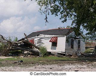 Hurricane Katrina - Lower Ninth Ward - a house rests on a...