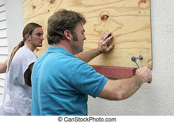 Hurricane Preparedness - Teamwork - A father & son preparing...