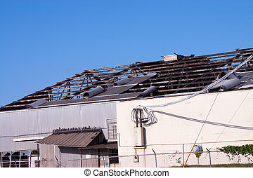 Hurricane Roof Damage - Commercial building destroyed by...