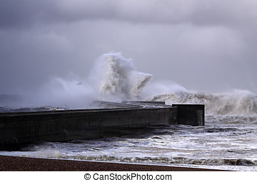 Hurricane - Stormy waves over pier and beacon. North of...