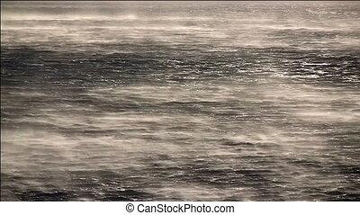Hurricane wind on sea