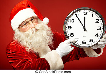Hurry for Christmas - Photo of Santa pointing at clock...