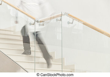 Hurry to save a life. Blur motion of doctor in white uniform hurrying and running upstairs