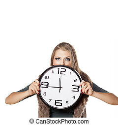 Hurry up - angry young girl holding a clock on white...