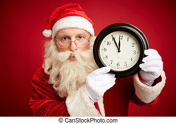 Hurry up for Christmas - Serious Santa Claus holding clock...