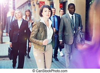 Hurrying woman walking on street