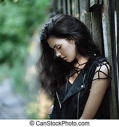 Hurt - Art portrait of young gorgeous brunette outdoors....