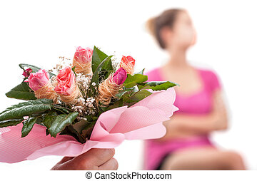Hurt woman and bouquet of flowers