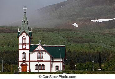 Husavik church at Husavik harbor, Iceland